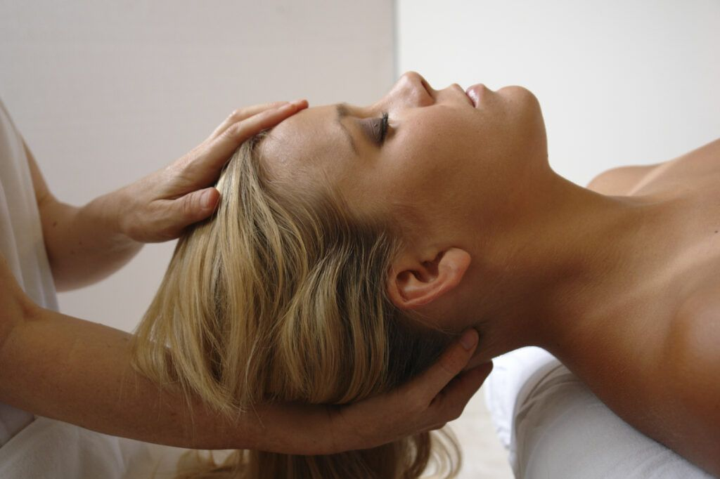 Chiropractor Holding Patient's Head